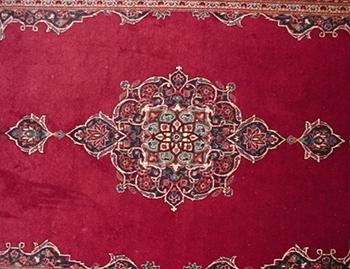 Immagine del medaglione centrale del tappeto Numero 10759 Kashan, Iran (Persia), 216 cm x 134 cm.